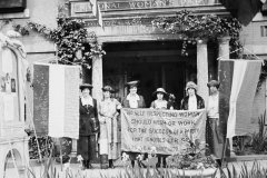 suffragists-holding-banner